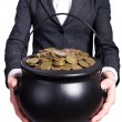 Woman holding pot of gold coins — Stock Photo #24770939