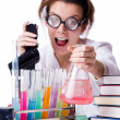 Crazy woman chemist in lab - Stok fotoğraf