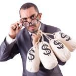 Man with sacks of money on white — Stock Photo #24775613