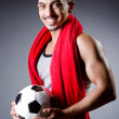 Football player with ball and towel — Stock Photo