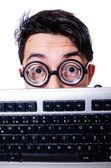 Grappige computer geek geïsoleerd op wit — Stockfoto
