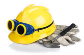 Helmet and tools isolated on white — Stock Photo
