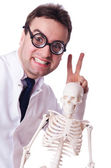 Funny doctor with skeleton isolated on white — Stock Photo