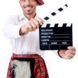 Stock Photo: Scotsmwith movie board on white
