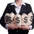 Woman with sacks of money on white — Stock Photo