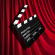 movie clapper board against curtain — Stock Photo #25352637