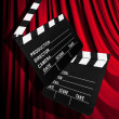 Movie clapper board against curtain — Stockfoto