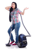 Young woman with vacuum cleaner on white — Stock Photo