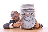 Businesswoman with giant alarm clock — Stock Photo