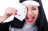 Nun playing cards on white — Stock Photo