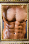Muscular man with picture frame — Stock Photo