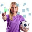 Woman with football pressing virtual buttons — Stock Photo #25602873