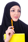Young muslim woman with book on white — Stock Photo