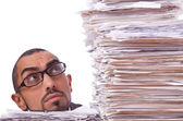 Busy businessman with lots of papers — Stock Photo