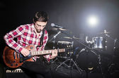 Man playing guitar during concert — Stock Photo