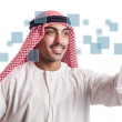Stock Photo: Arab pressing virtual buttons