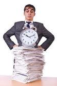 Woman businessman with giant alarm clock — Stock Photo