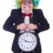 Funny clown with clock on white - Stock Photo