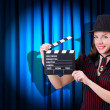 Woman gangster with movie clapper — Stock Photo