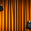 Movie clapper board against curtain — Lizenzfreies Foto