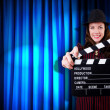 Woman gangster with movie clapper — Stockfoto