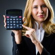 Businesswoman with calculator in business concept — Stock Photo