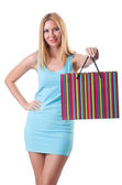 Tall girl after good shopping on white — Stock Photo