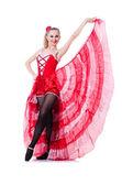 Girl in red dress dancing dance — Stock Photo