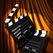 Movie clapper board against curtain — Stock Photo