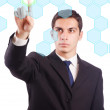 Young businessman pressing virtual buttons — Stock Photo