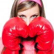 Young lady with boxing gloves on white — Foto Stock