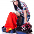Woman with too much stuff in her case — Stock Photo #27874515