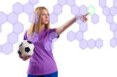 Woman with football pressing virtual buttons — Stock Photo