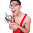 Stock Photo: Funny wrestler with winners cup