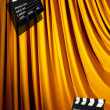 Movie clapper board against curtain — Foto Stock