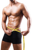 Muscular man measuring his muscles — Stock Photo