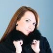 Portrait of a young woman wearing coat — Stock Photo #2875538