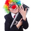 Funny clown with keyboard on white — Stock Photo