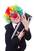 Funny clown with keyboard on white — Stok fotoğraf