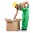 Stock Photo: Min green coveralls with boxes
