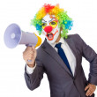 Businessman clown with loudspeaker on white — Stock Photo