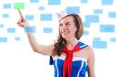 Young woman sailorpressing virtual buttons — Stock Photo