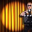 Girl with movie board against curtains — Stock Photo #30467549