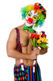 Clown with flowers on white — Stock Photo
