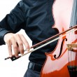 Hands playing cello at the concert — Stock Photo