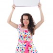Young woman with blank poster — Stock Photo #30880979