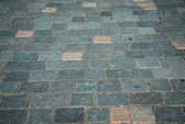 Old road paved with the cobble stones — Stock Photo