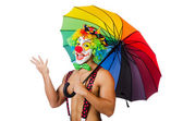 Clown with umbrella isolated on white — Stock Photo