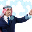 Arab man pressing virtual buttons — Stock Photo