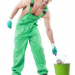 Stock Photo: Painter in green coveralls